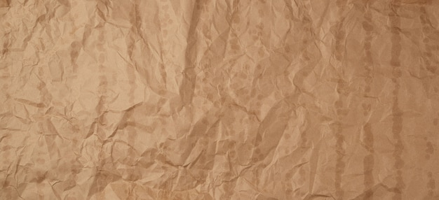 Crumpled brown kraft paper texture with bold spots