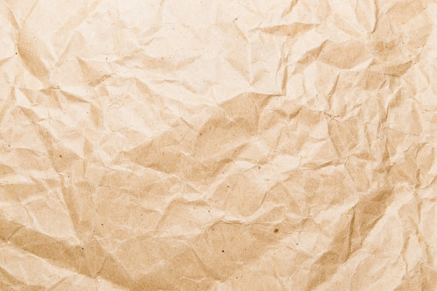 Crumpled brown paper. brown recycle paper background. backdrop for various purposes.
