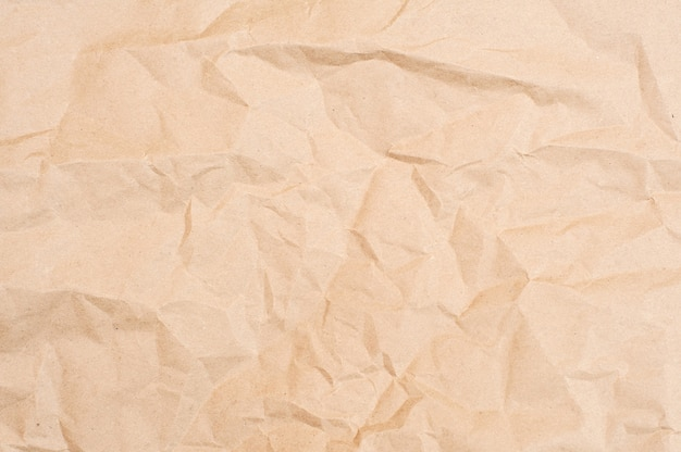 Crumpled brown paper texture. brown background