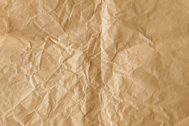 Crumpled brown paper textured background