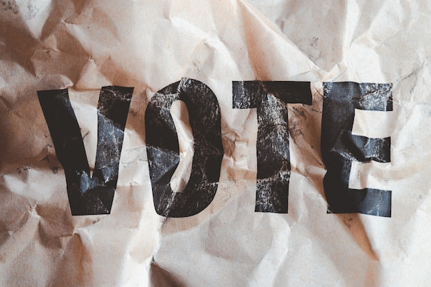 Crumpled brown paper withã'â word vote printed,ã'â collapse of democracy concept