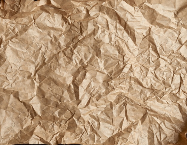 Crumpled brown parchment baking paper, full frame