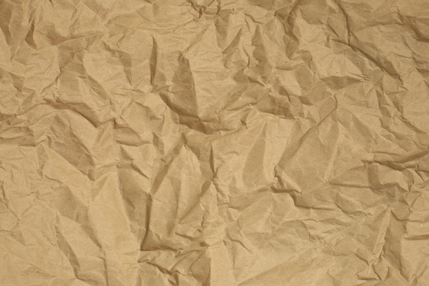 Crumpled brown recycled paper texture background. copy space