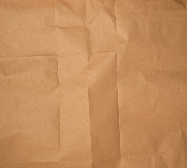 Crumpled brown sheet of paper, full frame