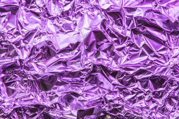 Crumpled colorful foil background.