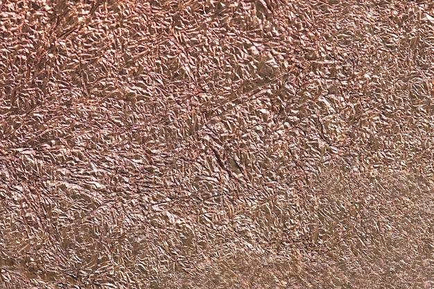 しわくちゃの銅の金属紙のテクスチャ背景