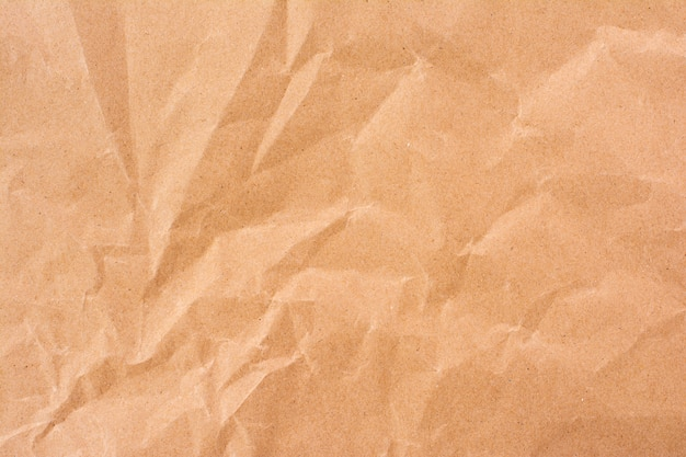 Crumpled craft paper texture abstract background