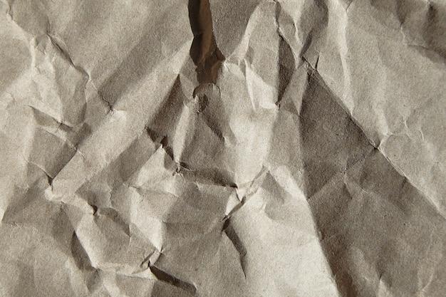 しわくちゃのクラフト紙のテクスチャ背景のクローズアップ