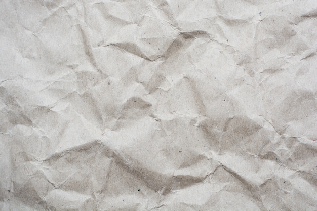 Crumpled cream color tone paper pattern texture background