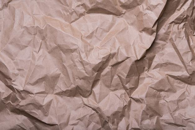 しわくちゃのクリームクラフト紙の背景テクスチャ。