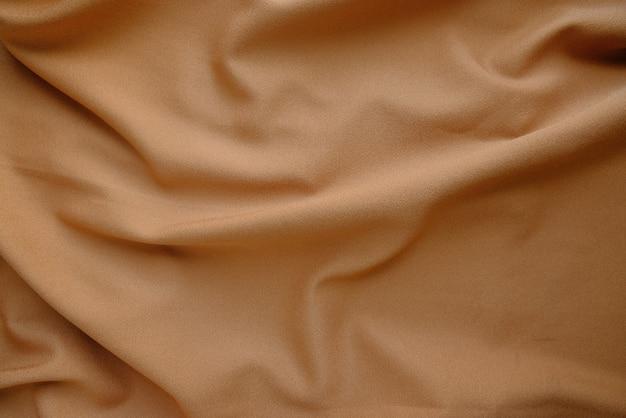 Текстура мятой ткани цвета латте