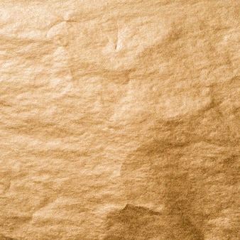 Crumpled foil of gold wallpaper