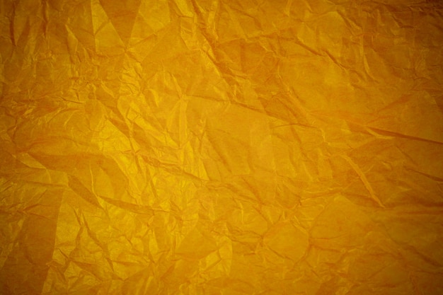 Crumpled gold paper recycling background.