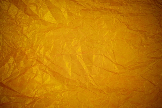 Мятой золотой переработанной бумаги фон