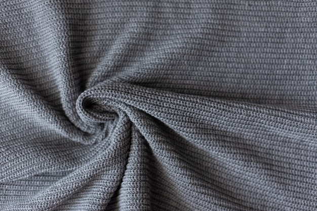 Crumpled gray knitted blanket. soft and warm fabric crumpled in folds.