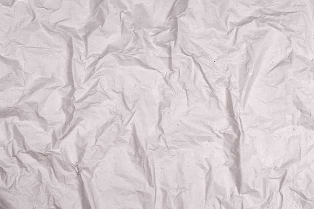 Crumpled gray paper texture. wrinkled paper background with cracks and kinks.