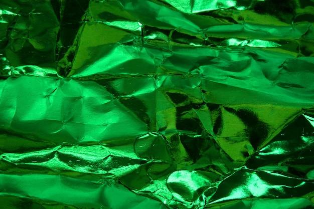 Crumpled green foil paper texture