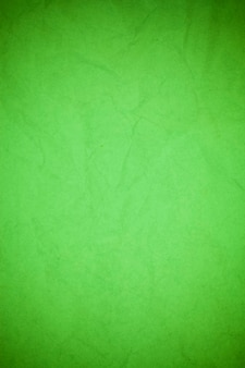 Crumpled green paper background.