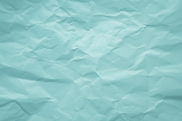 Crumpled green paper. pastel, soft color. abstract pattern.