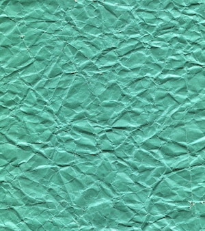 Crumpled green paper texture background