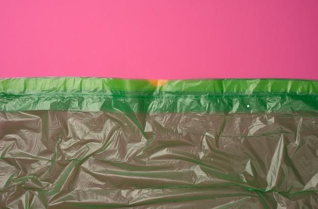 Crumpled green polyethylene texture, close up, full frame