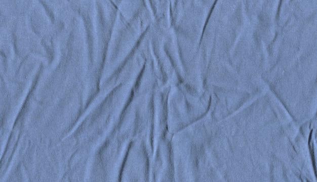 Crumpled light blue fabric texture