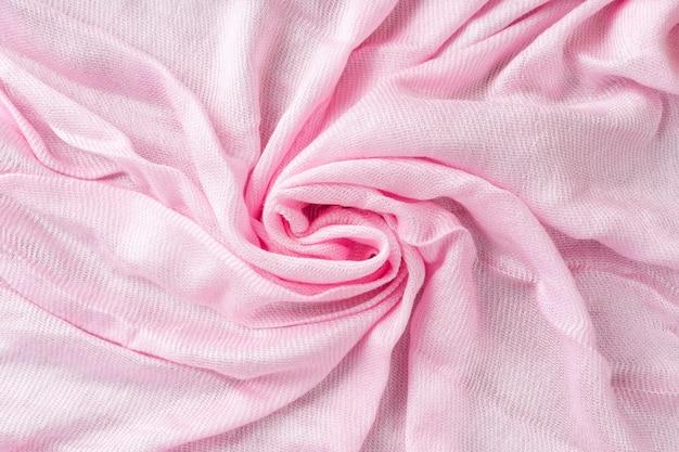 Текстура мятой льняной ткани. мятый текстиль. розовый.