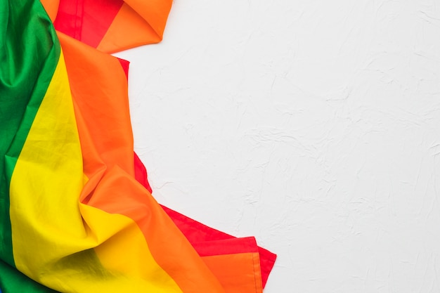 Crumpled multicolored cloth on white background