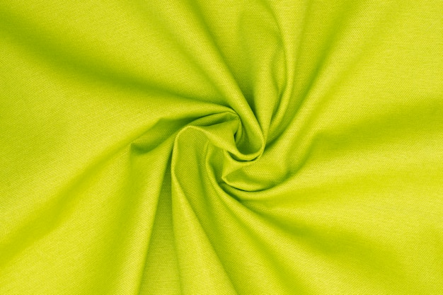 Crumpled neon green lime textured fabric background