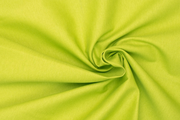 Crumpled neon green lime textured fabric.