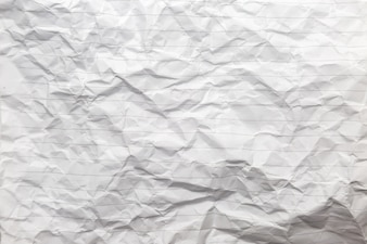 Crumpled of white blank paper with line background