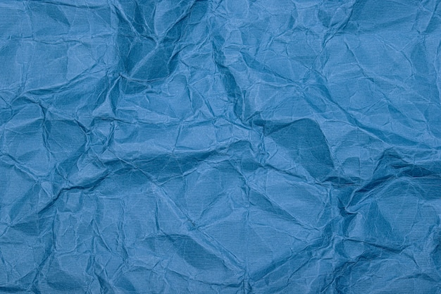 Crumpled paper (cardboard) background. crumpled old vintage blue wrapping paper with texture