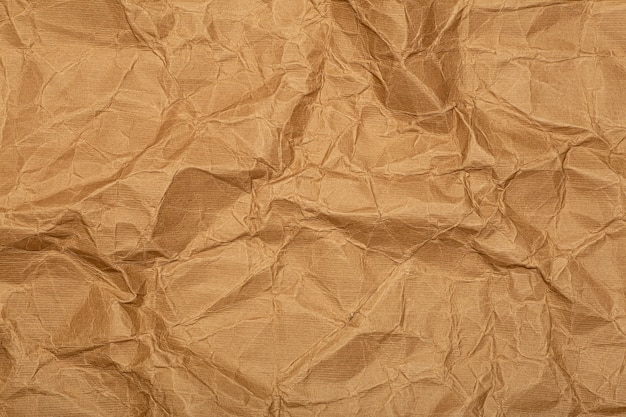 Crumpled paper (cardboard) background. crumpled old vintage wrapping paper with texture