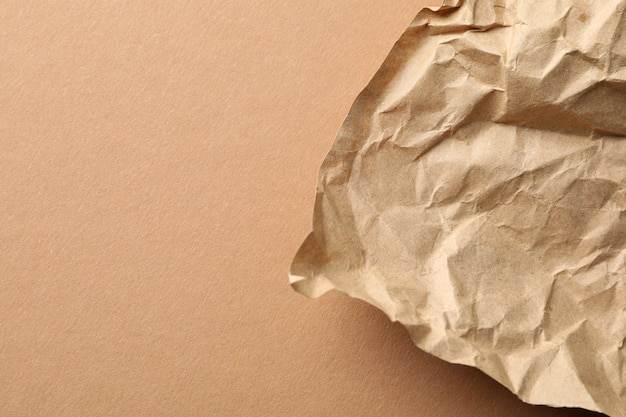 Crumpled paper on craft, close up and space for text