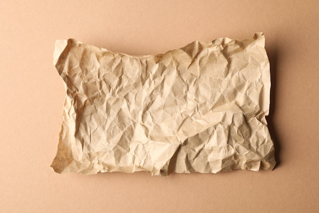 Crumpled paper on craft, top view