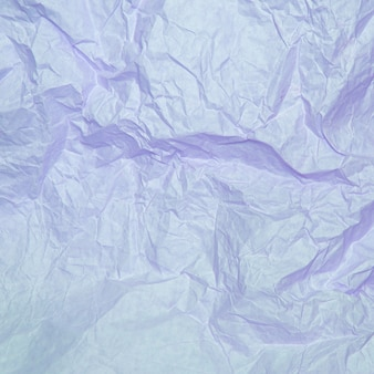 Crumpled paper texture of light purple color.