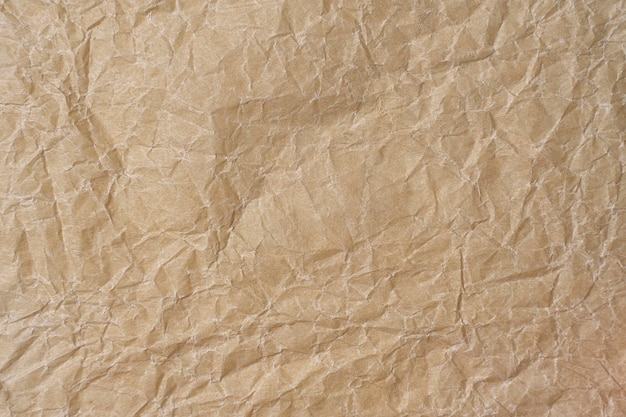 Crumpled parchment texture. paper beige background