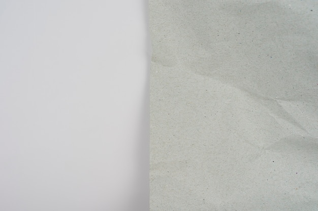 Crumpled piece of grey recycle paper on white background top view copy space for text and design