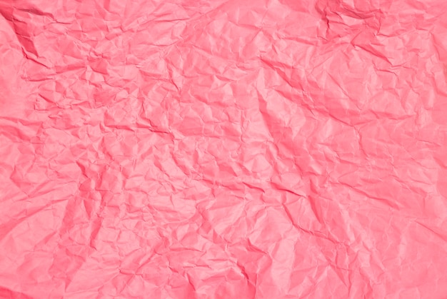Crumpled pink paper background texture
