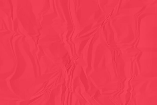 しわくちゃの赤い紙の背景をクローズアップ