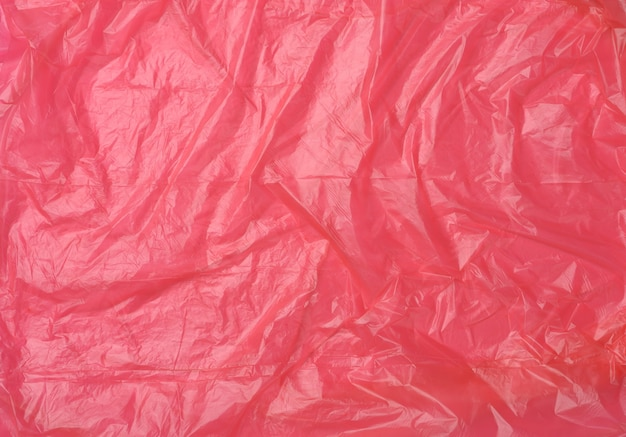 Crumpled red polyethylene texture, close up, full frame
