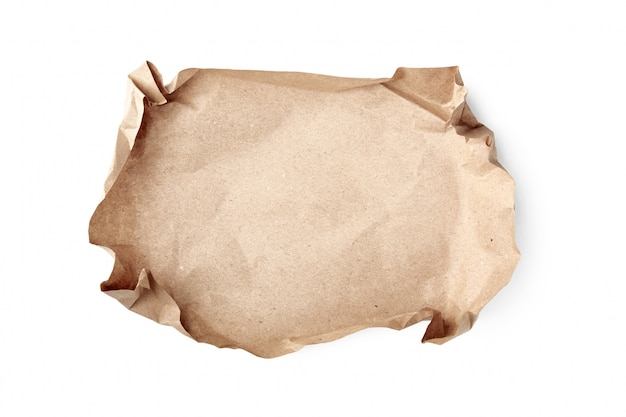 Crumpled sheet of craft paper on white. recyclable material.