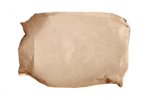 Crumpled sheet of craft paper on white table
