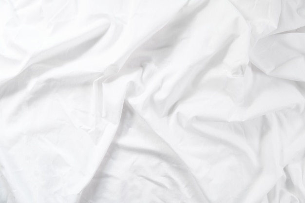 Crumpled sheet. morning bed. white fabric texture.