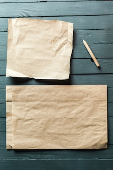 Crumpled sheet of paper and pencil