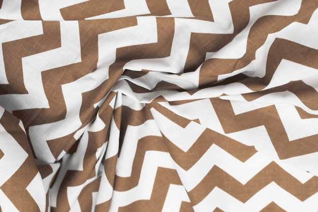 Crumpled texture background fabric brown and white with a pattern.