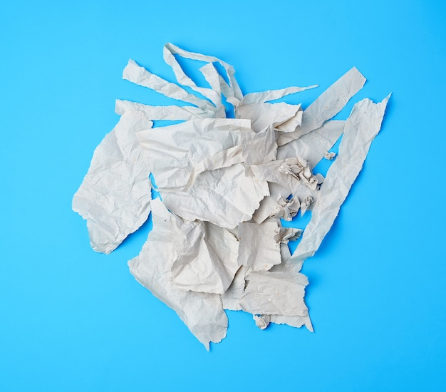 Crumpled torn piece of gray paper