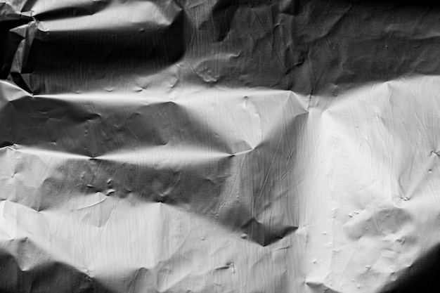 Crumpled up silver foil background