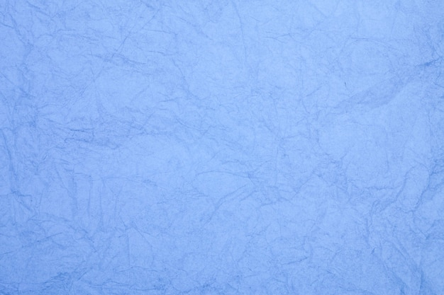 Crumpled vintage blue paper textured obsolete background.