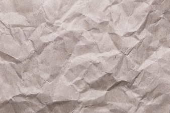Crumpled vintage paper texture background for the design surface backdrop in your work.